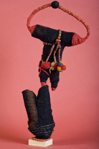 "Balancing Act, Felted wool and needle knitting, 25""x 13"""